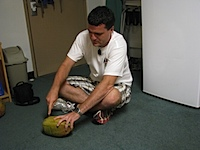 20111104-Jared-SawingCoconut.jpg